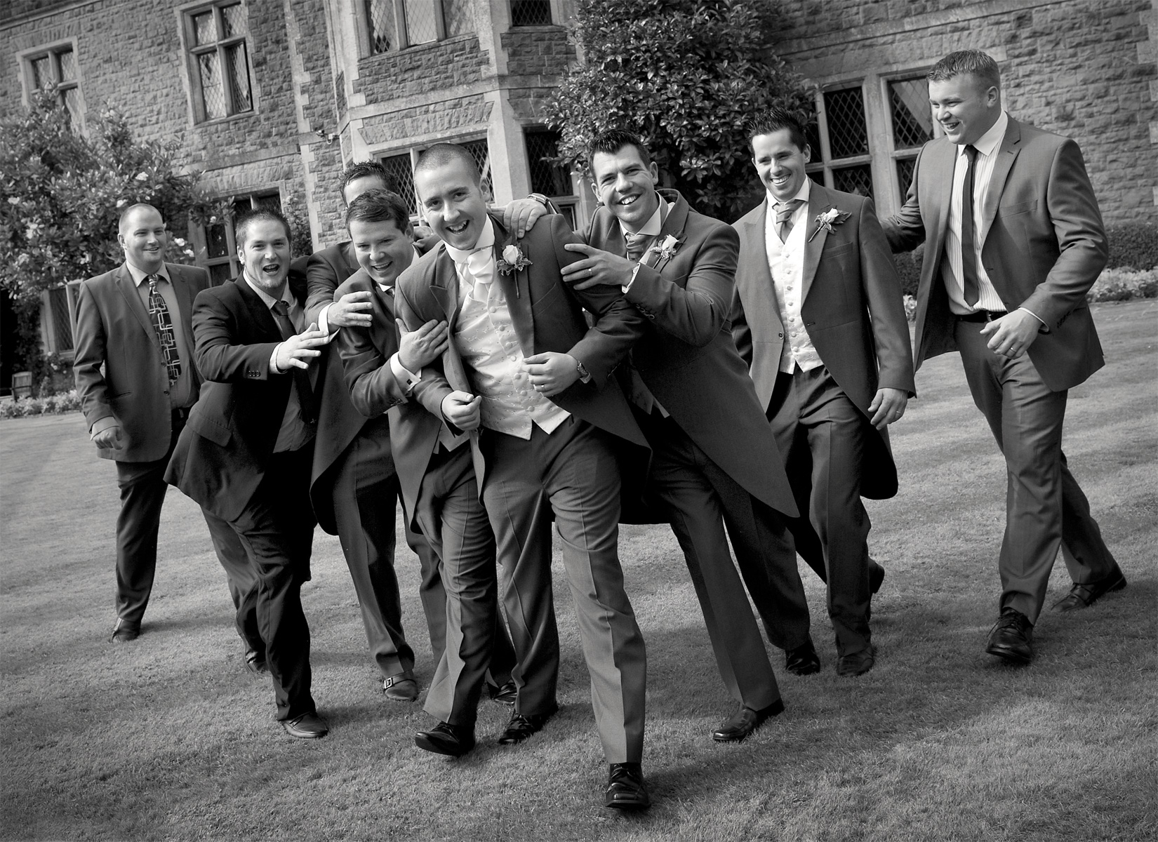 Miskin-Manor-wedding-photography,groom-and-ushers-black-and-white-wedding-photography