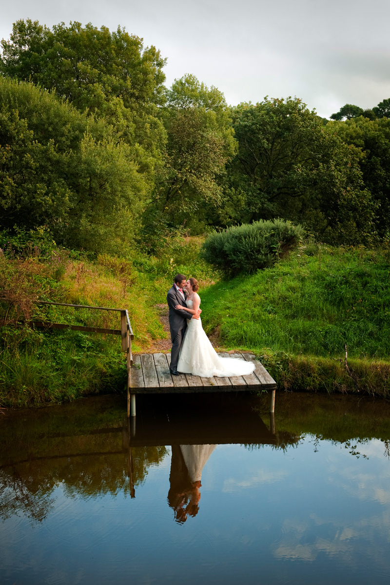 Bride-and-groom-Gellifawr-hotel-jetty-lake-reflections-Fishguard-wedding-photography