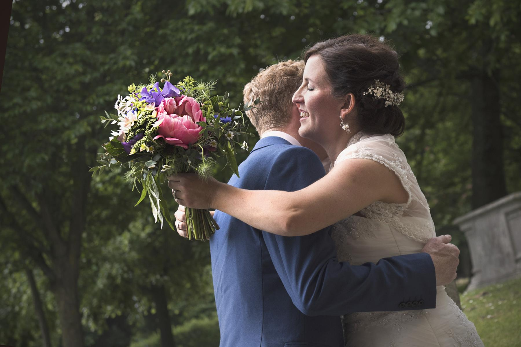 bride-groom-hug-summer-wedding-photography-south-wales-wedding-photographer