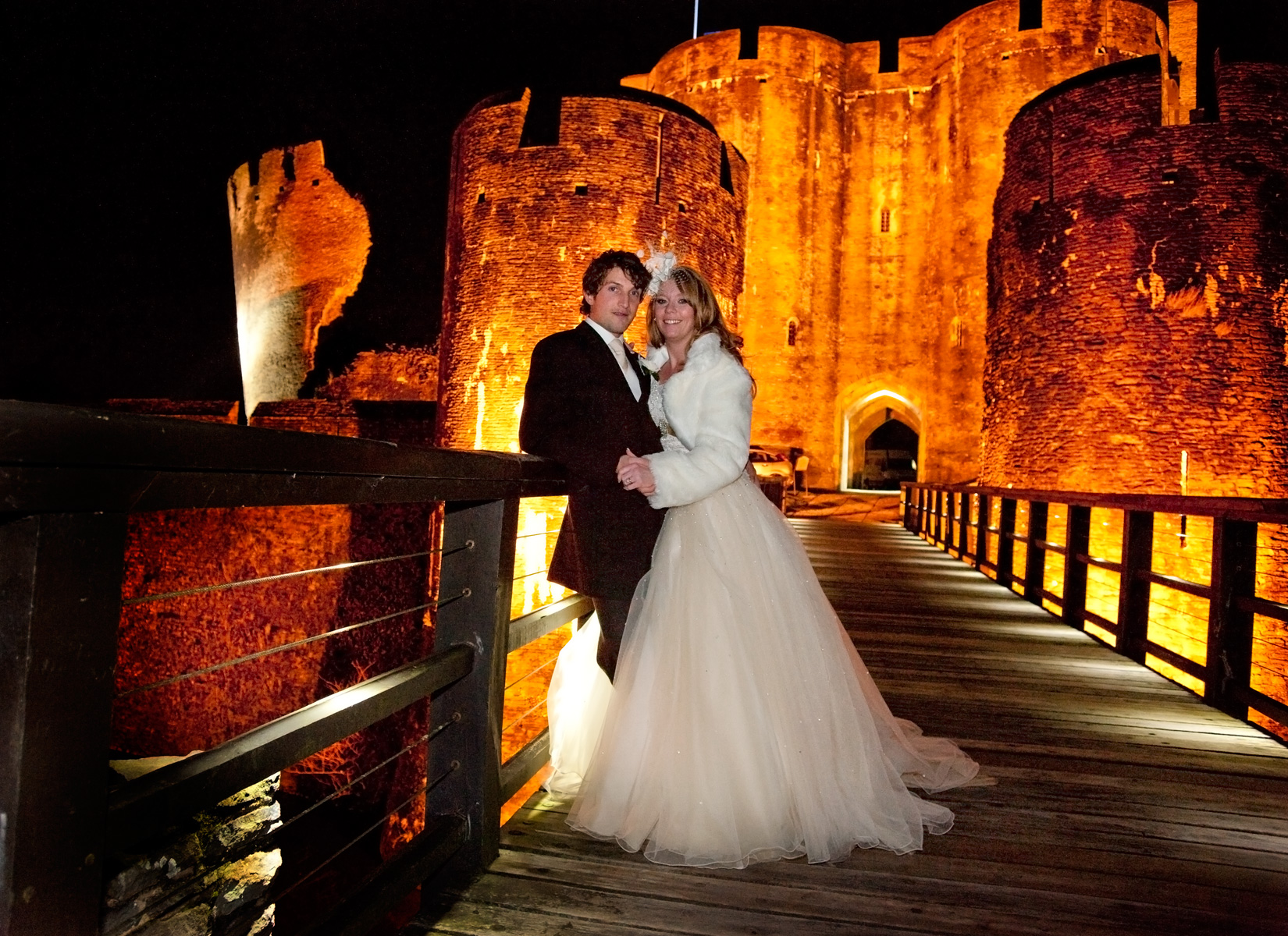 Winter-weddings-bride-groom-caerphilly-castle-floodlit-south-wales-winter-wedding-photography