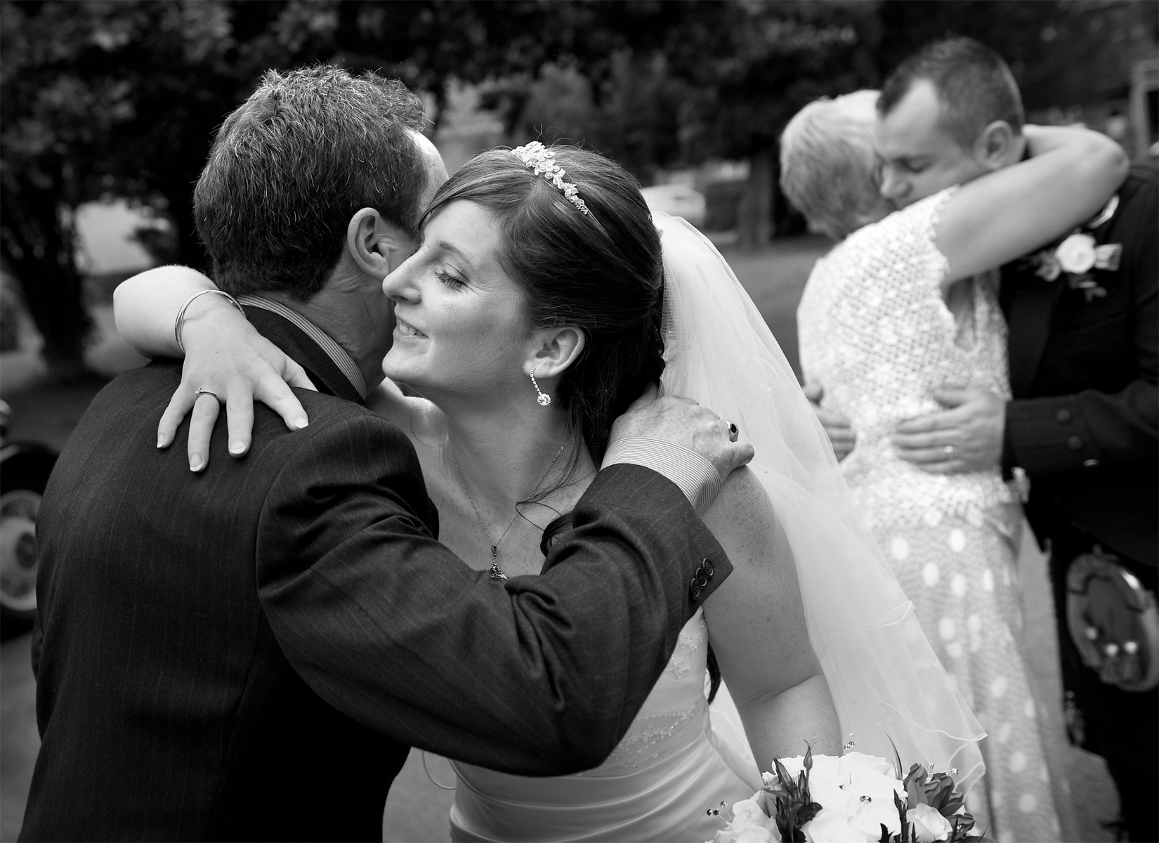 South-wales-reportage-wedding-photographers-bride-hugging-guest-Aberdare-wedding-photography.
