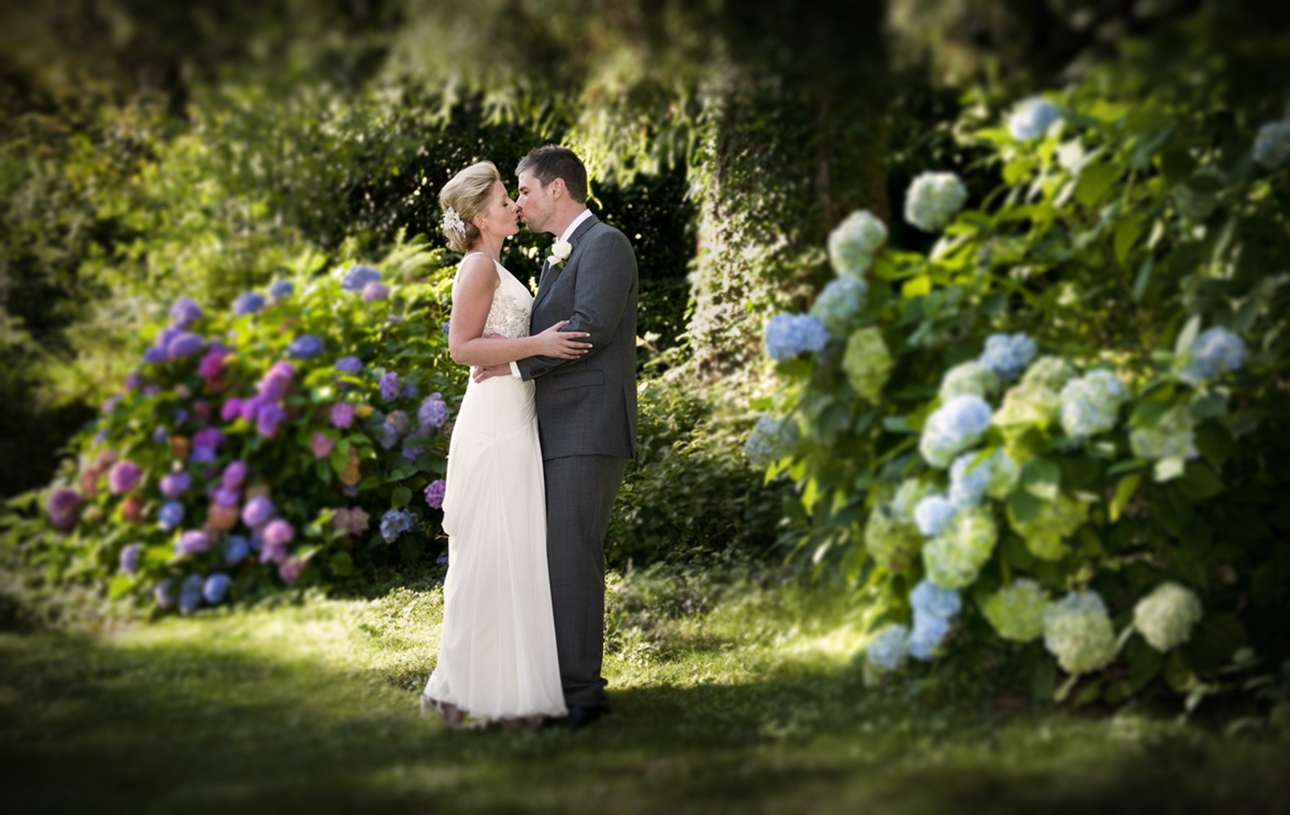 new-house-hotel-wedding-photographer-bride-groom-kissing-romantic-wedding-photographers-south-wales.jpg