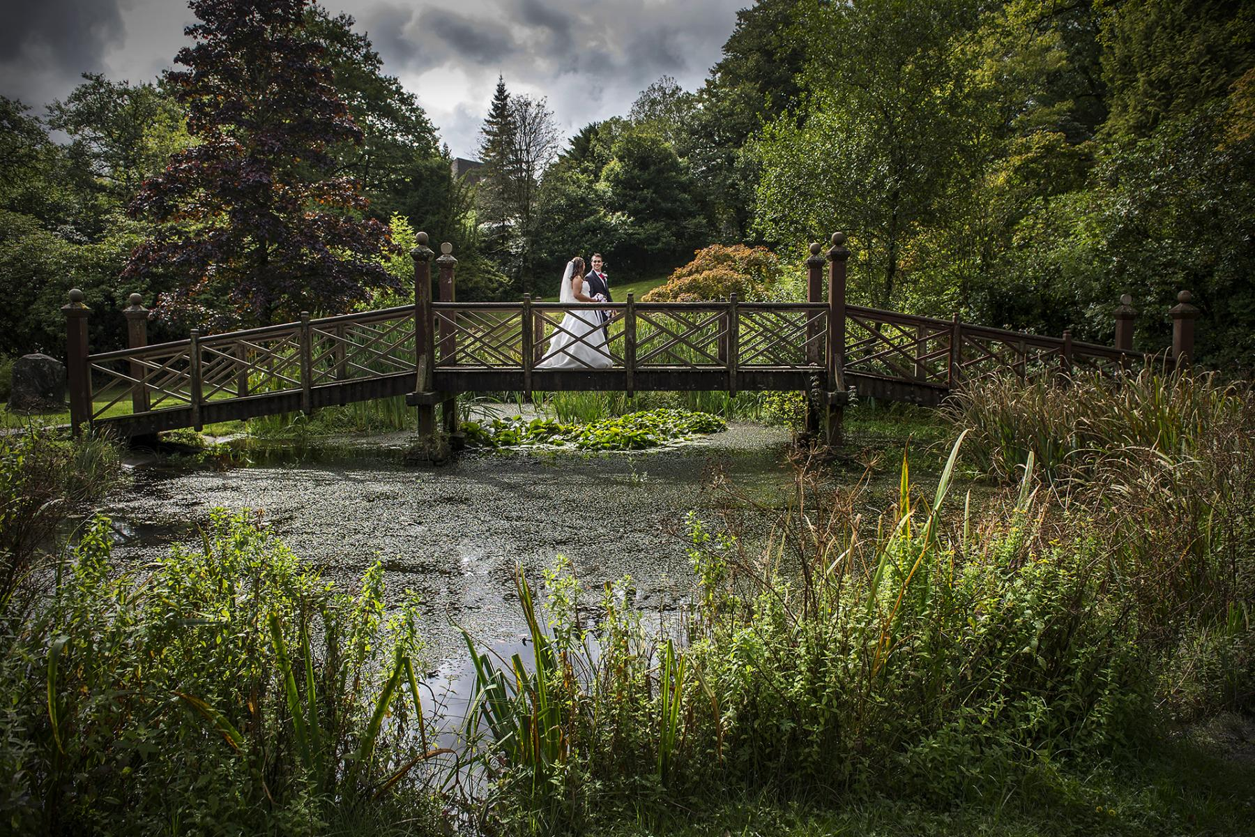 South-wales-wedding-Bryngarw-house-wedding-photographer-bride-groom-footbridge-summer-wedding-photographs