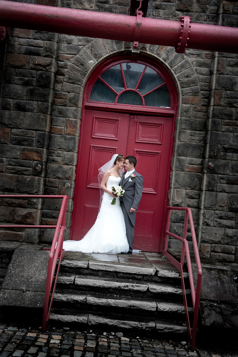 Pontypridd-wedding-photography-Bride-and-Groom-red-doorway-Rhondda-Heritage-center-wedding-photographer