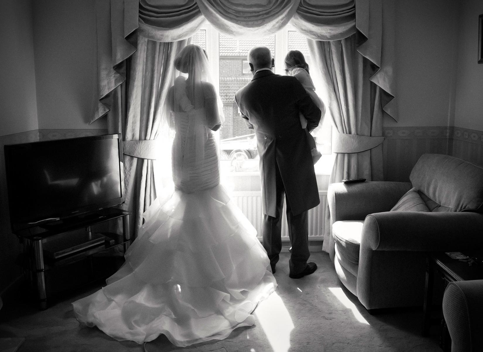 Bride-and-father-waiting-for-wedding-limo-South-Wales-wedding-photography