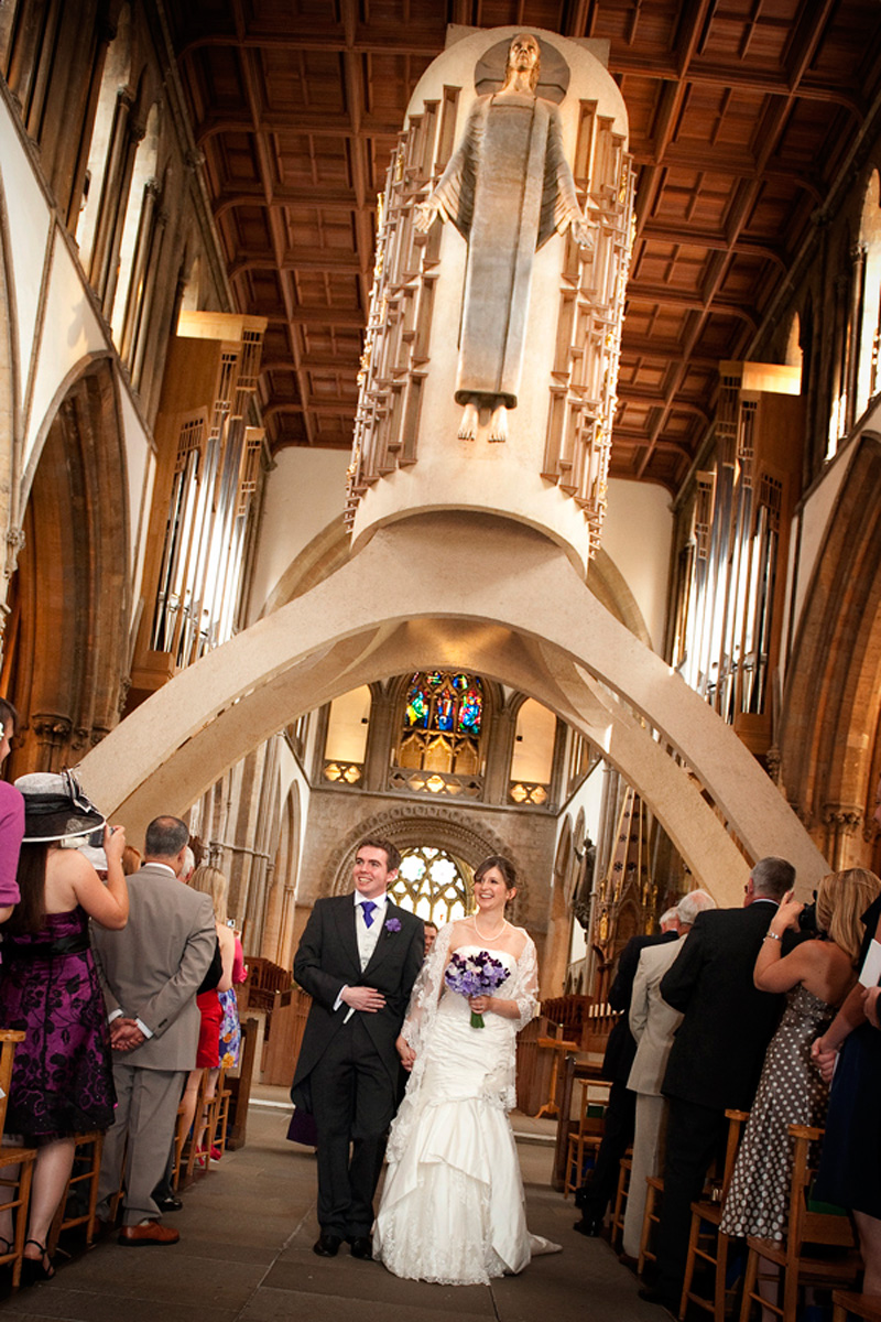 Llandaff-Cathedral-wedding-photographer-Bride-and-Groom-walking-down-aisle-cardiff-wedding-photographers