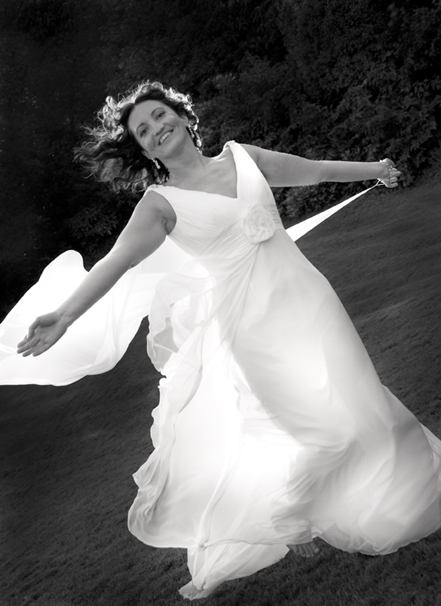 Bride-running-the-rectory-galndore-black-and-white-wedding-photography