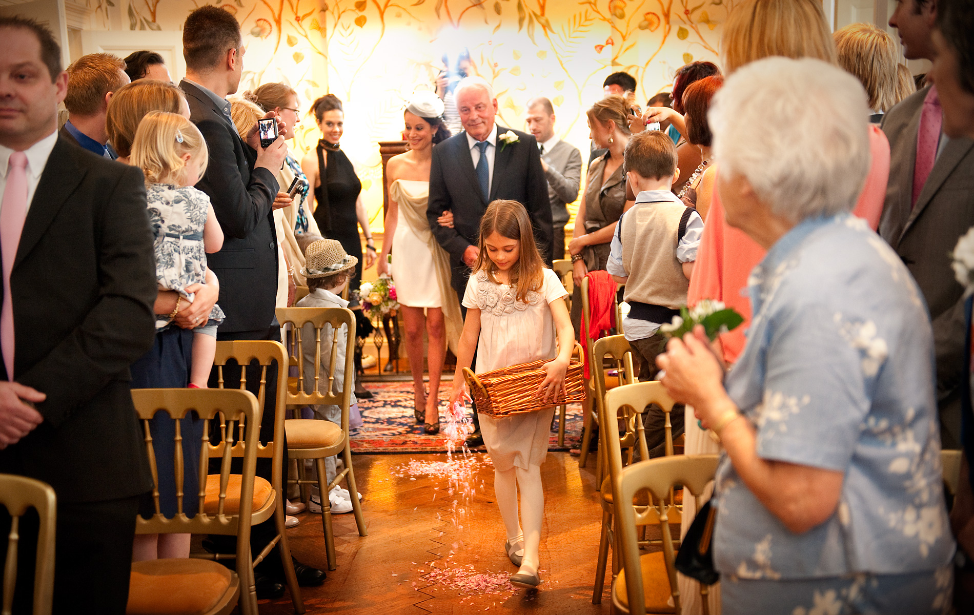 South-wales-photographer-flower-girl scattering-petals-wedding-ceremony-gliffaes-hotel-crickhowell.