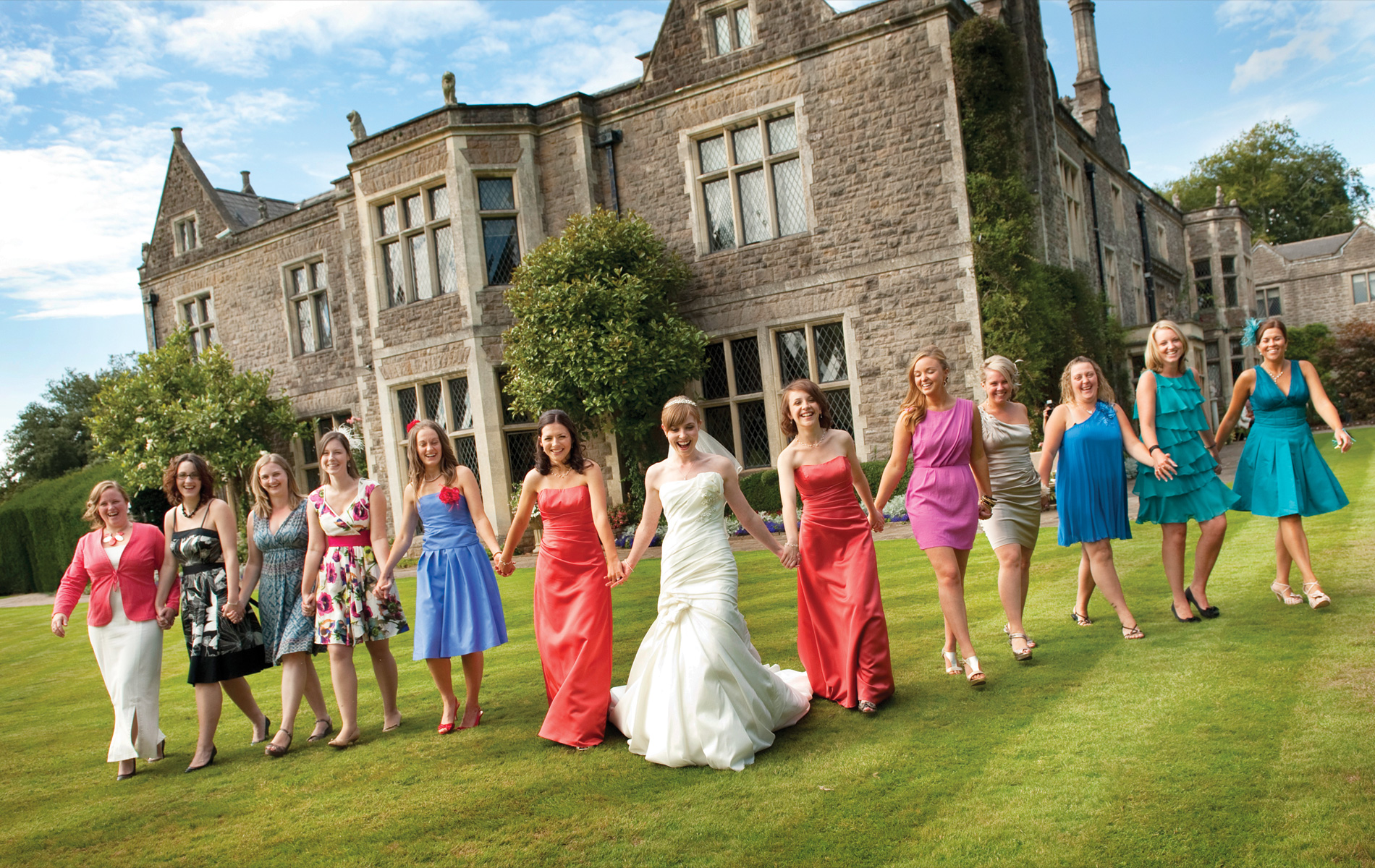 Miskin-Manor-Hotel-summer-wedding-bride-colourful-guests-south-wales-wedding-photographers