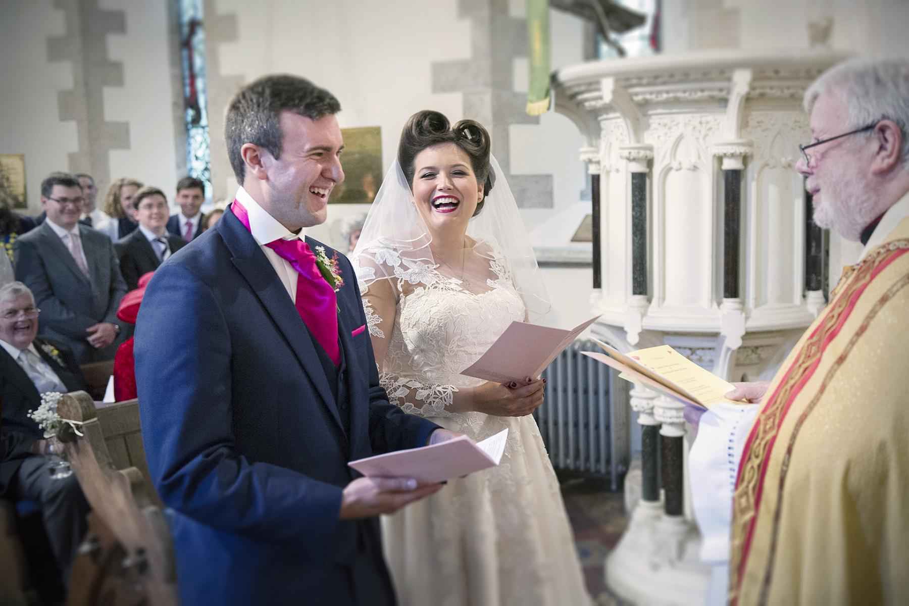 wedding-laughing-bride-groom-reportage-wedding-photography-south-wales-St-teilo's
