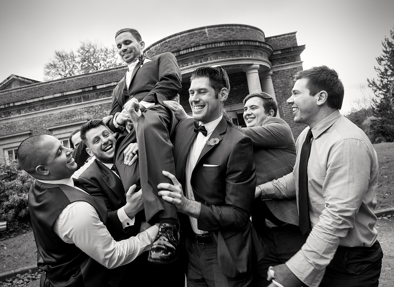 De-courceys-wedding-photographer-ushers-groom-natural-wedding-photographers-south-wales-B&W-wedding-photographs